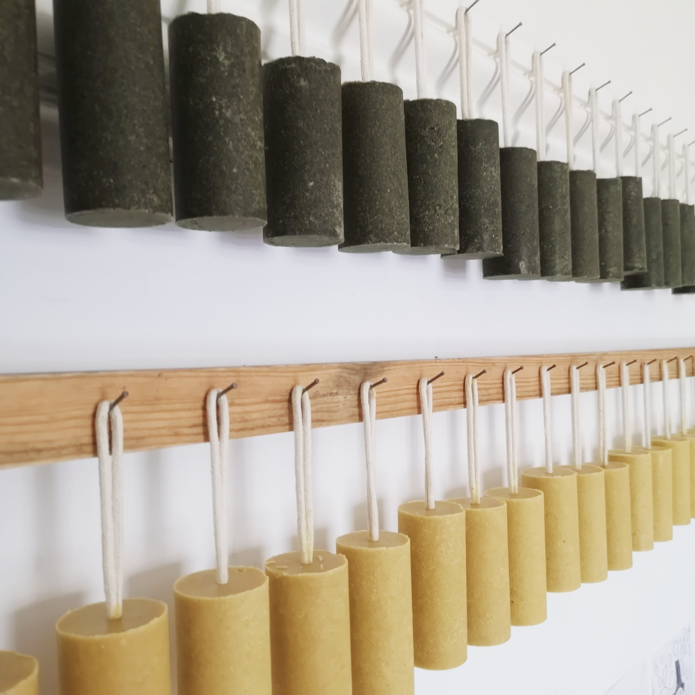 Shampoo bars hanging on a wooden rack