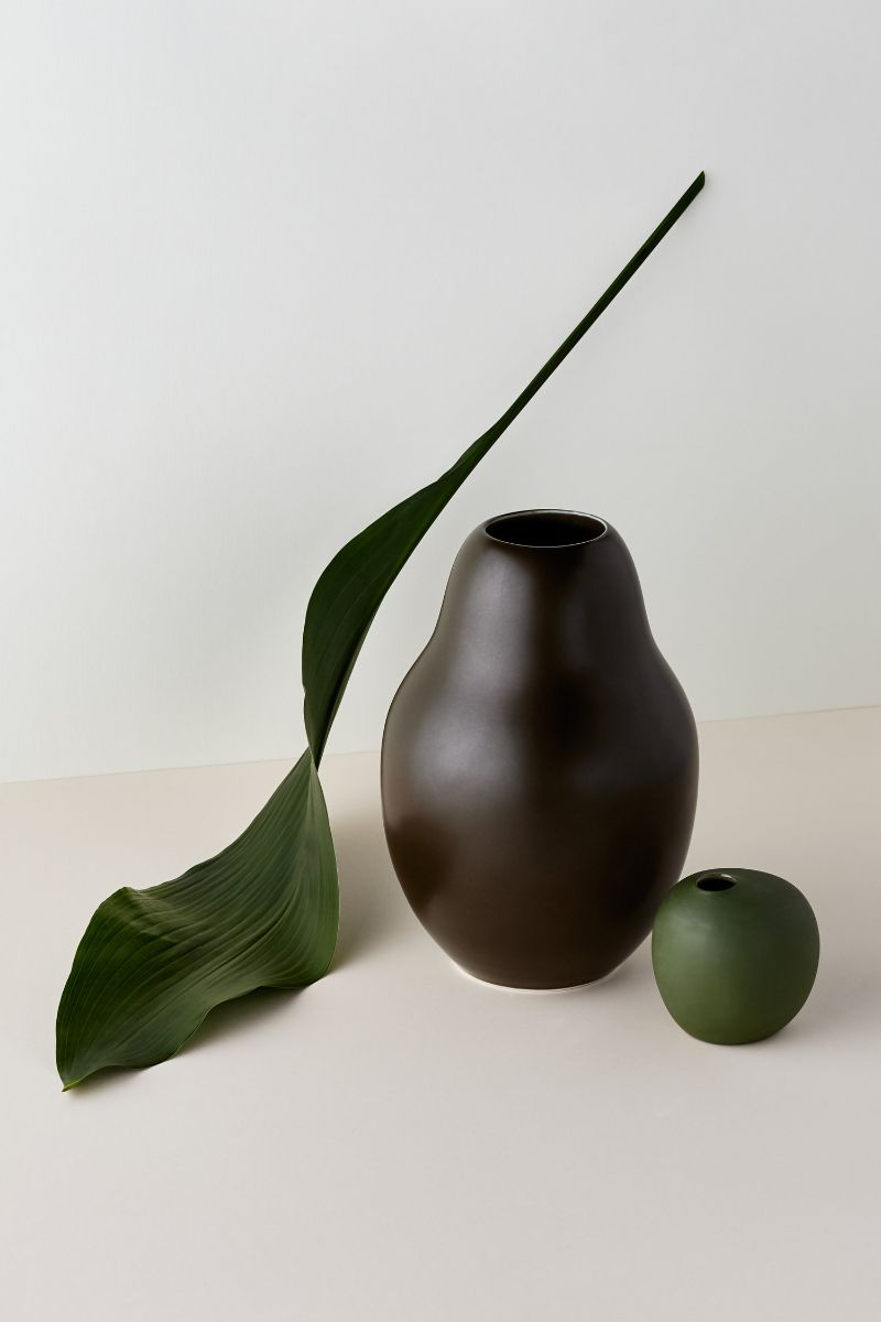 Two pomelo shape vases and green leaf