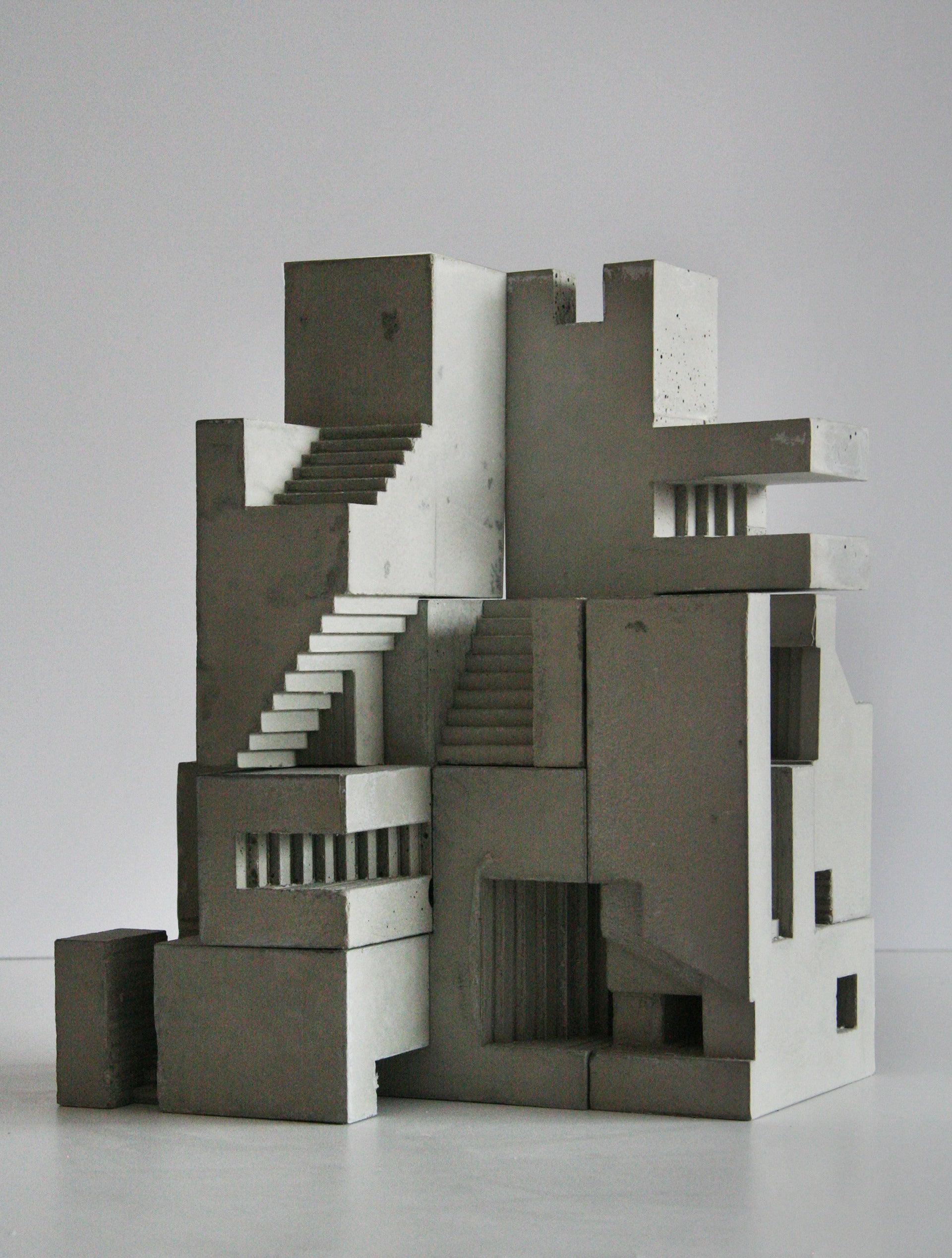 Small geometrical concrete building with stairs