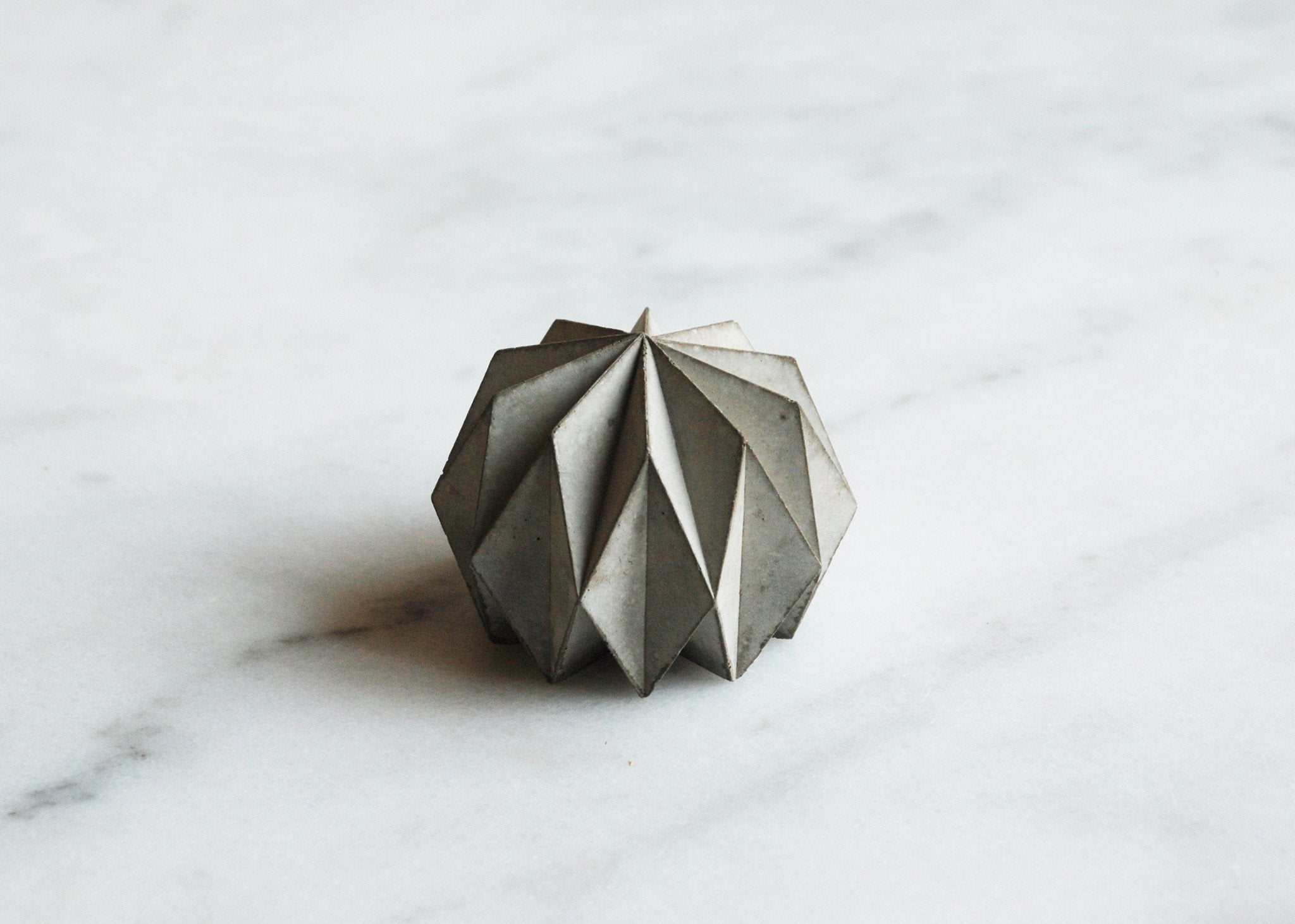 One small concrete origami object