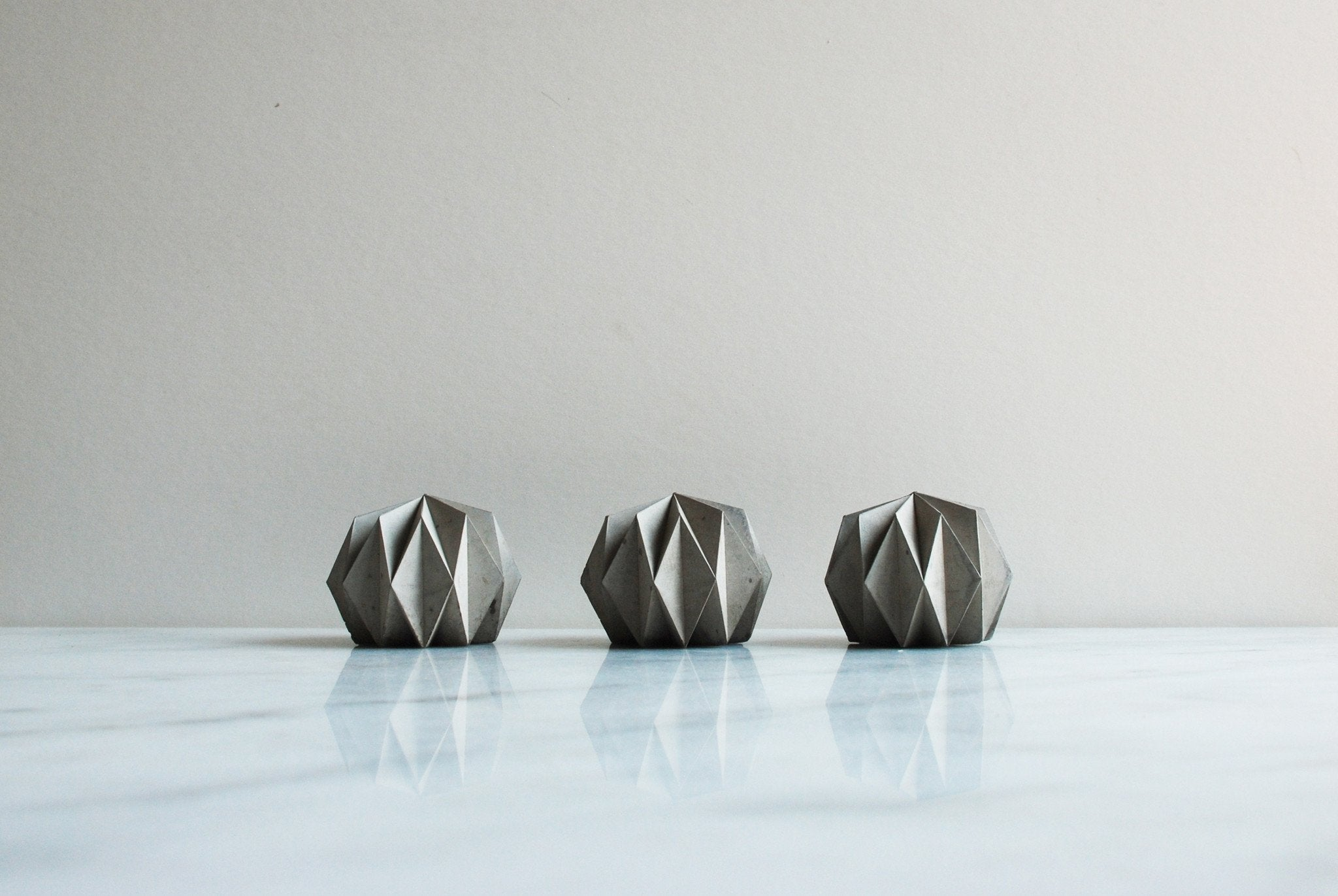 Three small origami shaped paperweights