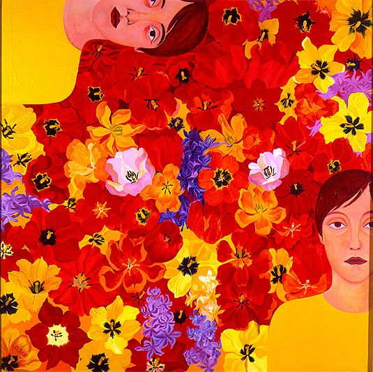 Two women  in front of yellow and red flowers