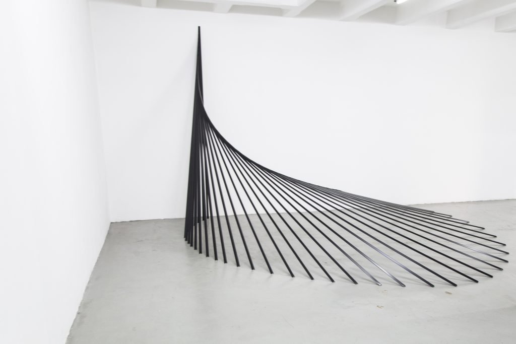 An image of a black installation in a gallery
