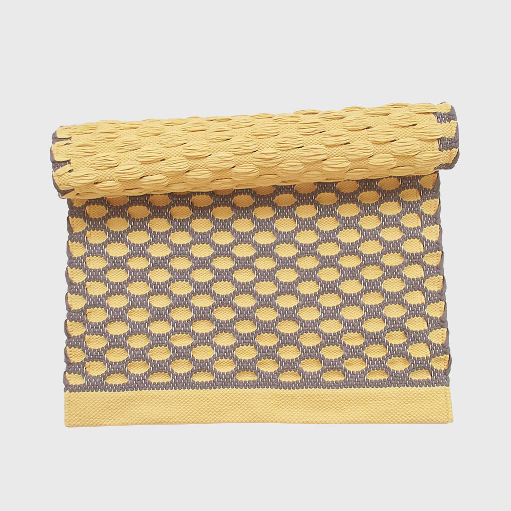 Yellow and brown comb rug