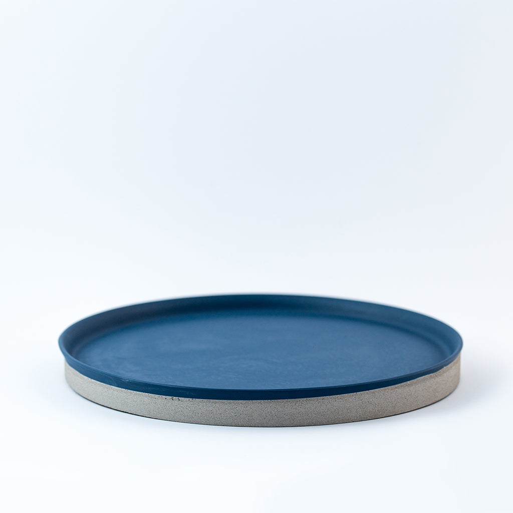 A blue porcelain and concrete platter