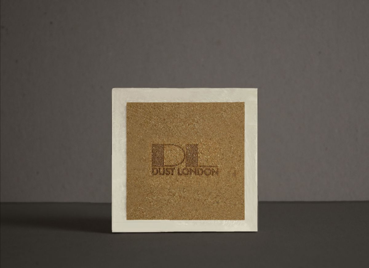 Brown coaster with Dust London logo