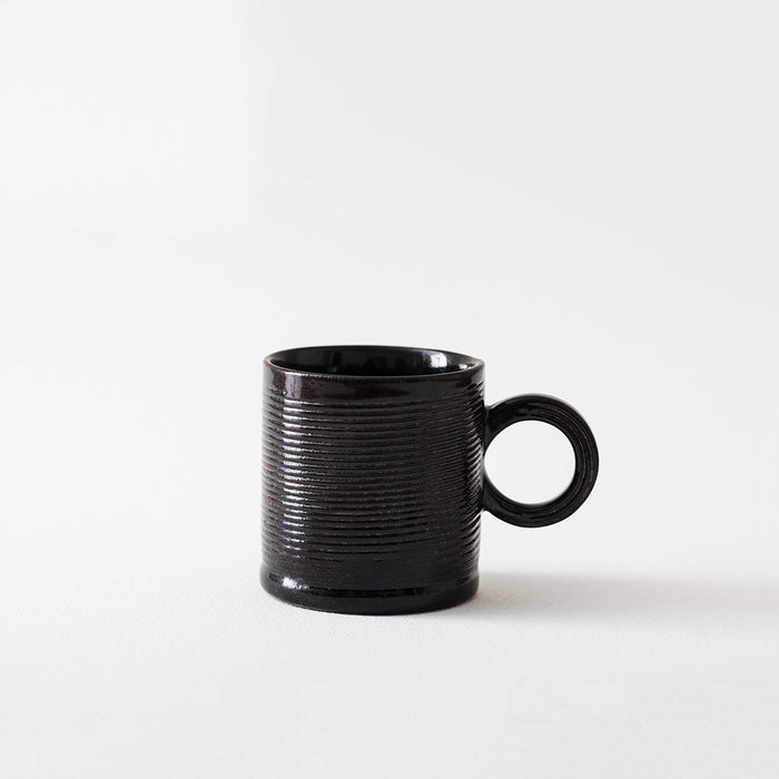 Striped Black Mug by Jarõna Ilo