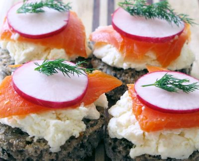 Homemade fresh cheese with salmon, radishes, and dill