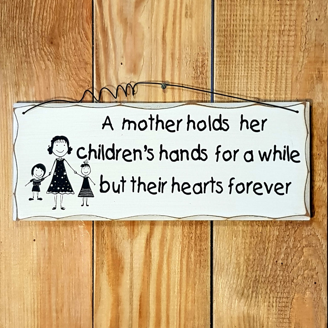 A mother holds...