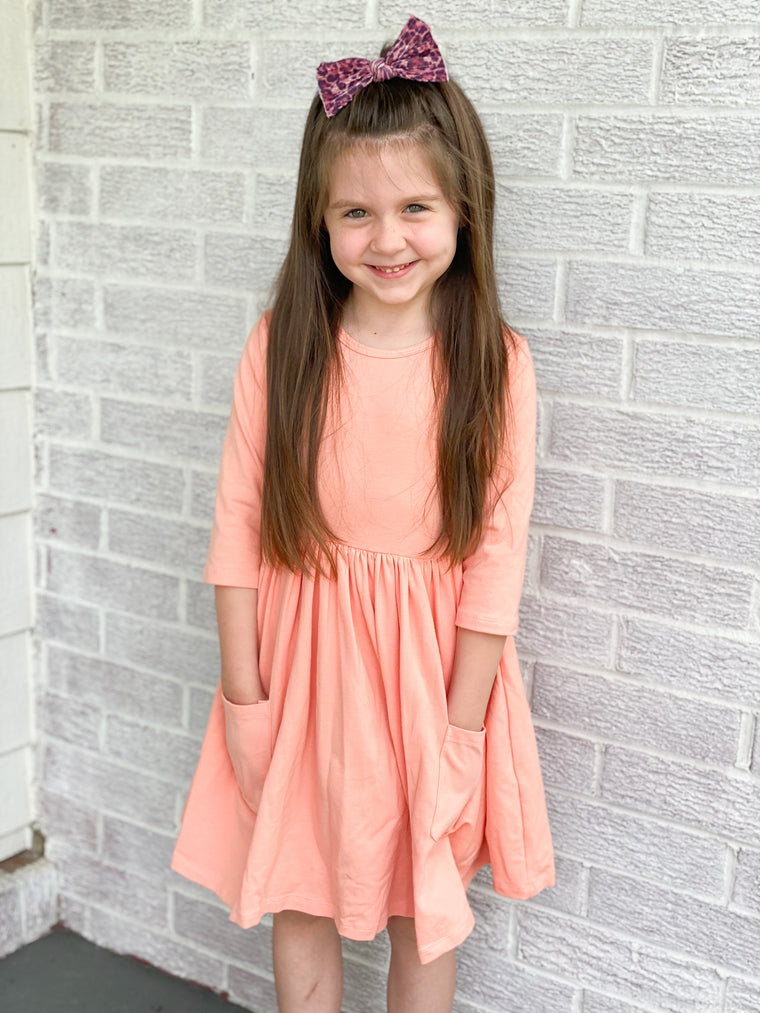 BRIGHT PEACH SWING DRESS