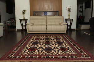 A 6.5 feet by 9 feet berjesta wool kilim, the colours used on the rug are beige,red and blue.