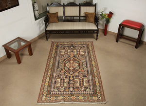 A 4 by 7 feet caucasian wool kilim, the colours used on the carpet are beige,blue,red,orange, black and yellow.