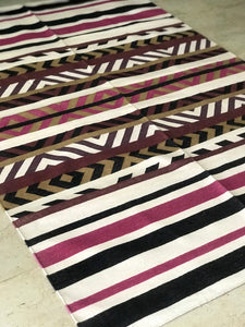 This striped cotton dhurrie is 4 feet by 6 feet.