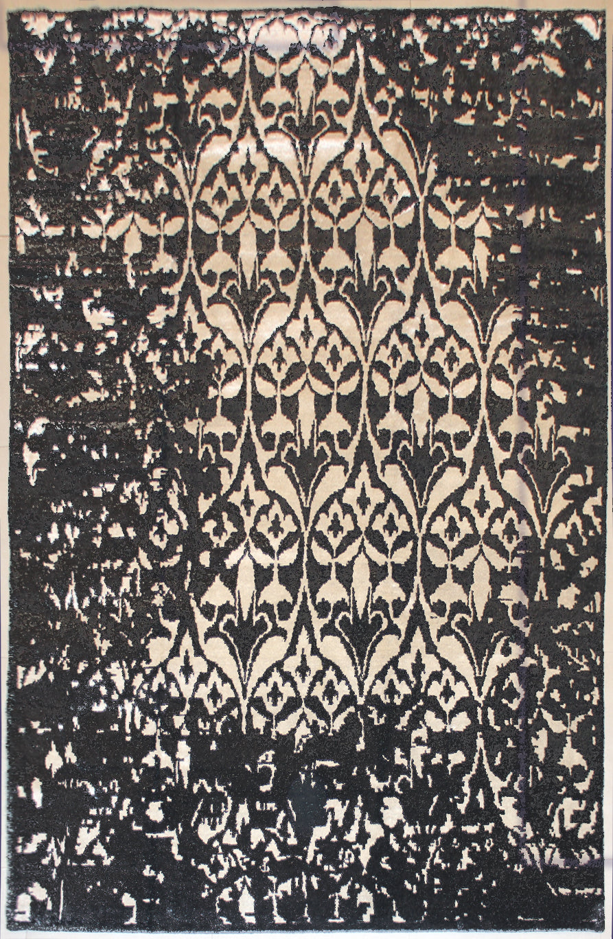 A black and white erased rug that is 8 feet by 10 feet.