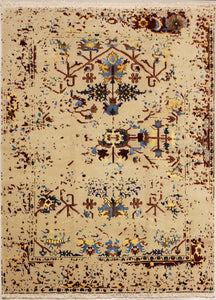 8 feet by 11 feet rug predominantly in off white in colour. With browns, blues and yellows.