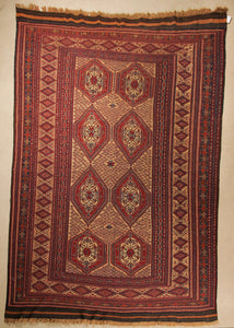 An almost 7 by 10 feet balochi wool kilim. Colours include mainly brick, orange and a light rust.
