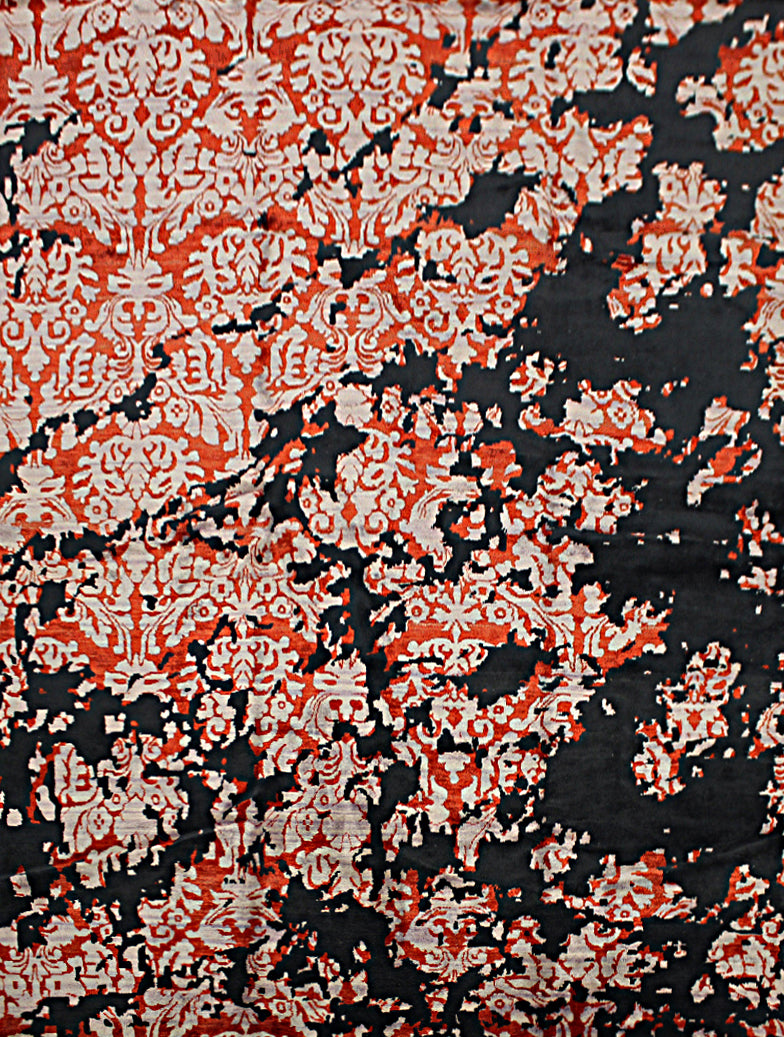 An 8 feet by 11 feet rug with an black, red and white floral erased pattern.
