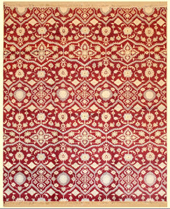 8 feet by 10 feet modern rug. 8 feet by 10 feet modern rug. The colours mainly include red, beige and tan.