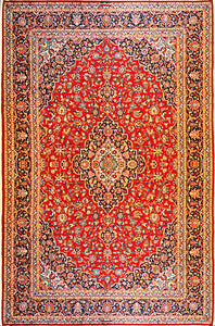 A 10 feet by 14 feet antique persian wool rug with red, beige and blue colours.