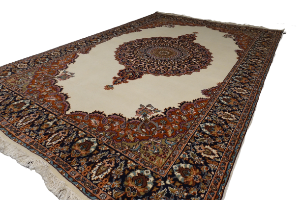 A 6 feet by 9 feet Kashmiri woolen rug, the colours used on the carpet are beige,gree,brown and blue.