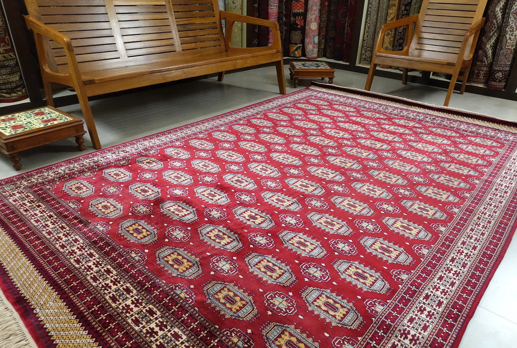 A 6 feet by 9 feet kashmiri silk on silk rug. The colours used on the carpet are white,yellow,cream and red.