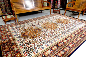 It is a 6 feet by 9 feet Indian wool rug. The colours used are rust,beige,blue and brown.