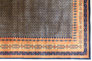 A 4 feet by 6 feet indian wool rug, the colours used on the rug are rust,brown and dark blue.