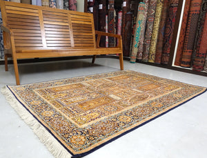 It is a 4 feet by 6 feet pure silk kashmiri rug. The colours used on the rug are blue,green,gold and beige.