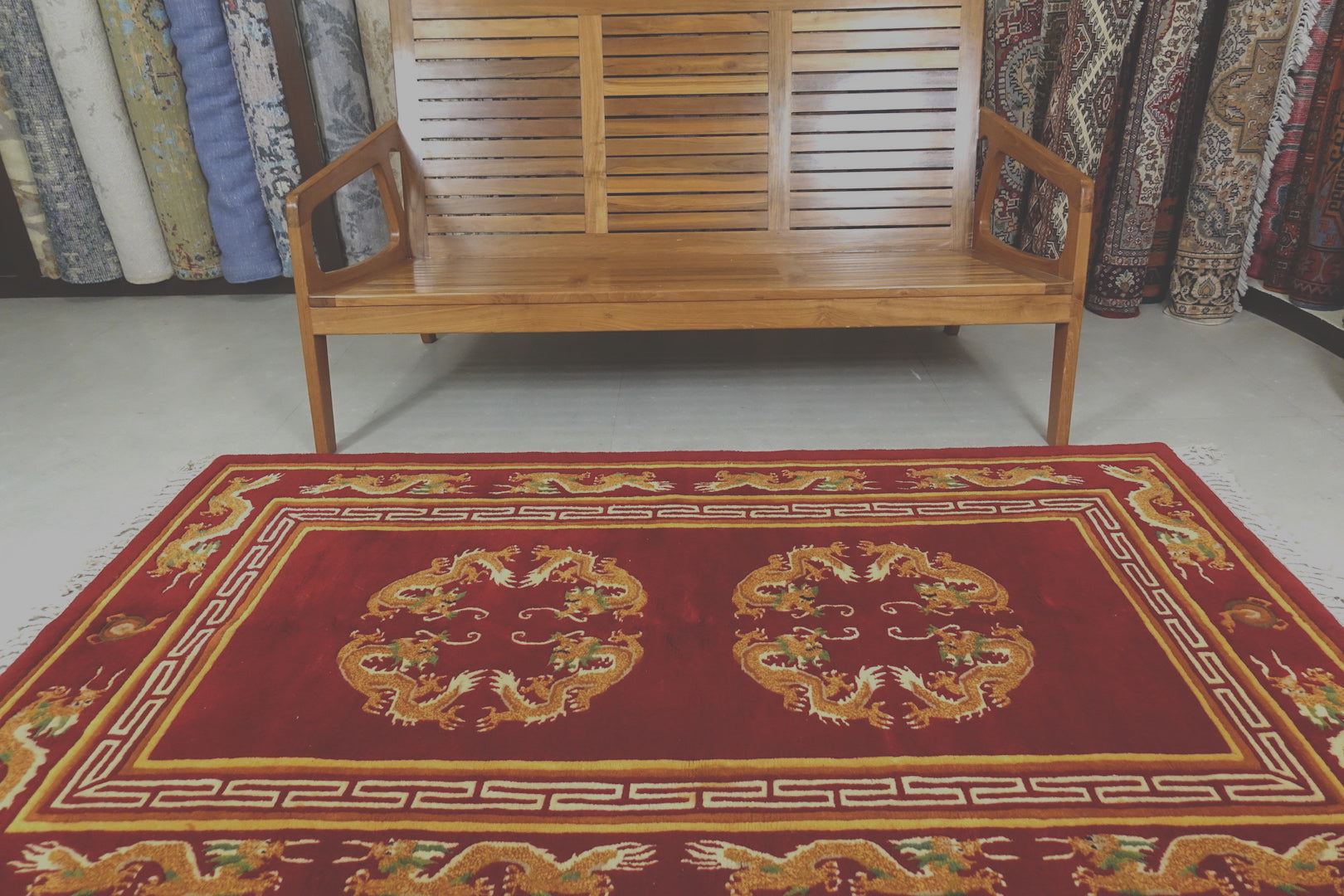A 4 by 7 feet tibetan wool rug. The colours used are red,beige and tan.
