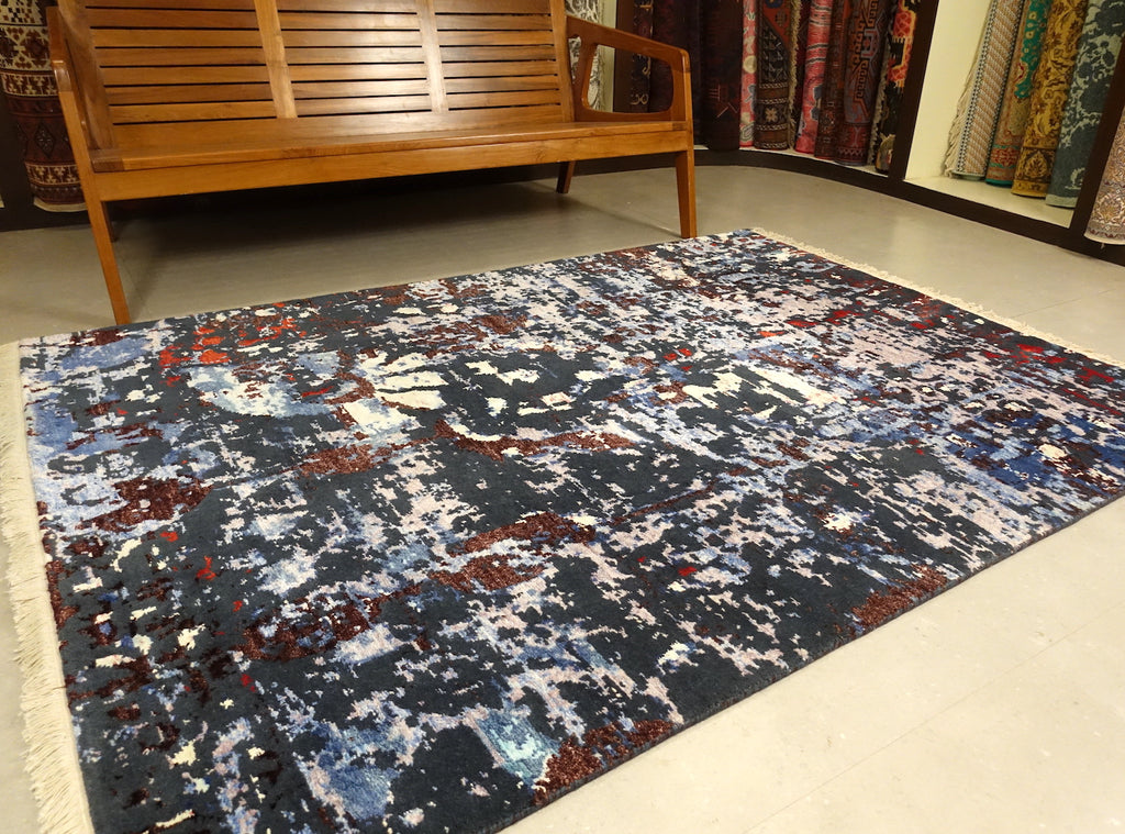 Modern Rugs/Carpet With Abstract Design. Predominantly with Blue and Green Colors. The rug is 5 feet by 7 feet.