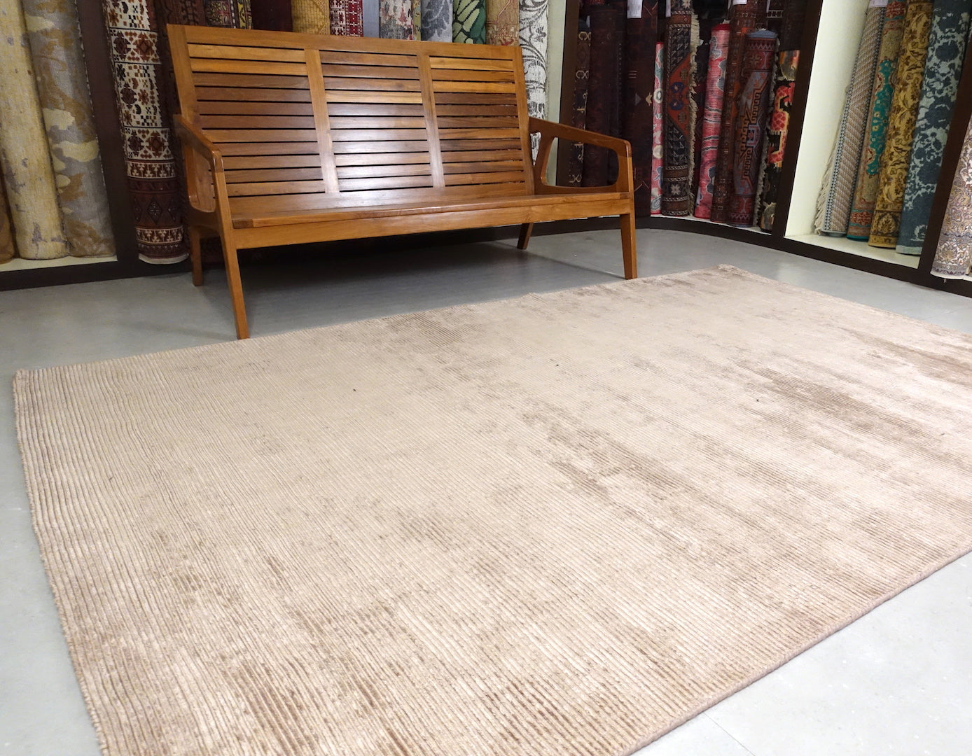 A 5 feet by 8 feet rug in brown.