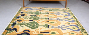 6 feet by 4 feet Yellow Ikat design rug.