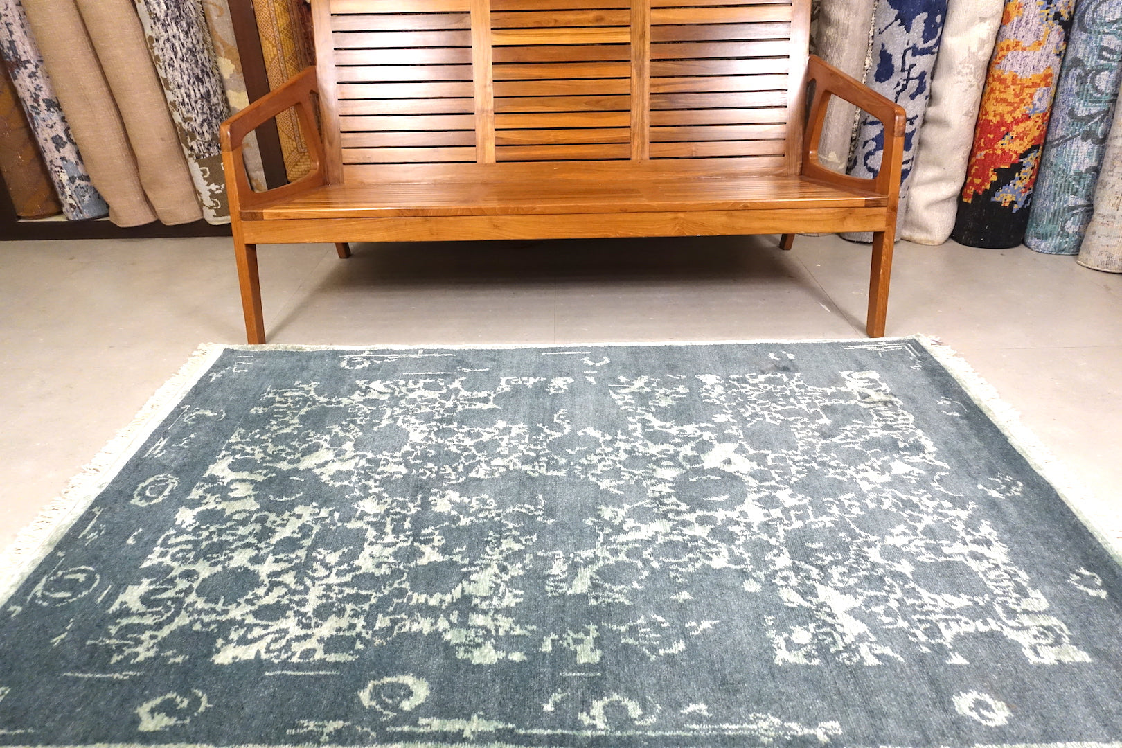 A 6 feet by 4 feet erased rug with floral pattern.