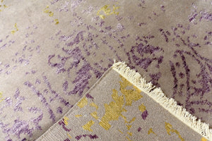 A 4 feet by 6 feet rug with an erased design in light purple as a based with sprinkle of yellow and darker purple.
