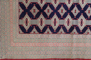 A 5 by 6 feet afghani wool rug. The colours used on the carpet are red, deep blue and beige.