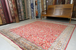 It is a 7 feet by 7 and a half feet silk on silk kashmiri rug. The colours used on the rug are red,beige and white.
