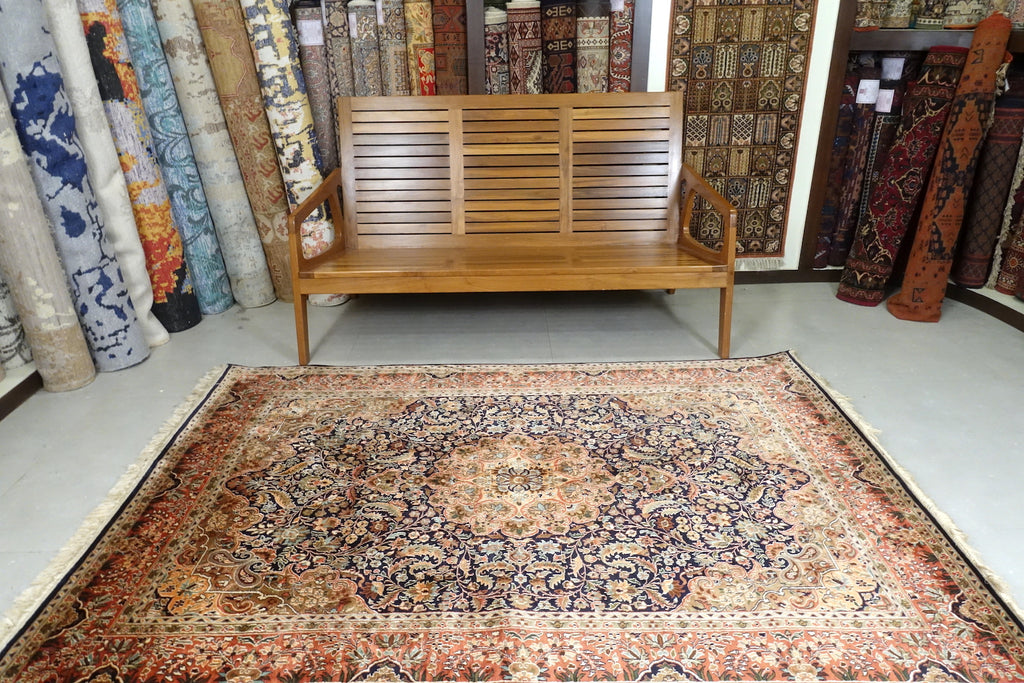 A 5 by 7 feet kashmiri silk rug.