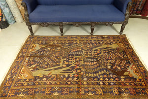 A 4 by 6 feet balochi rug. The colours primarily include beige, brick, rust, blue and green.