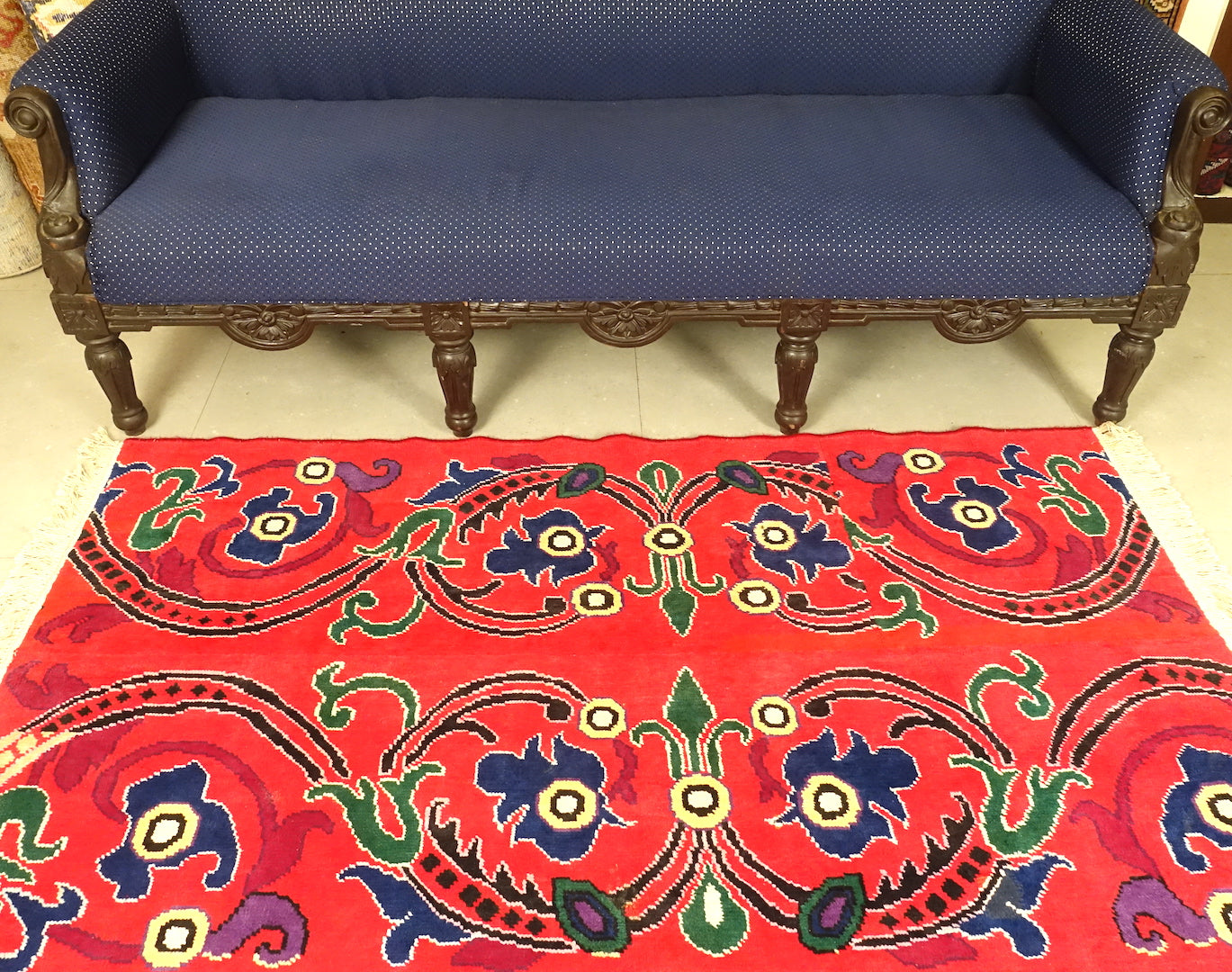 A 3 feet by 5 feet tibetian wool rug. The colours used on the rug are red,blue,beige and yellow.
