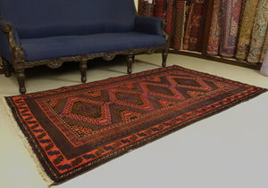A 4 by 7 feet balochi wool rug.