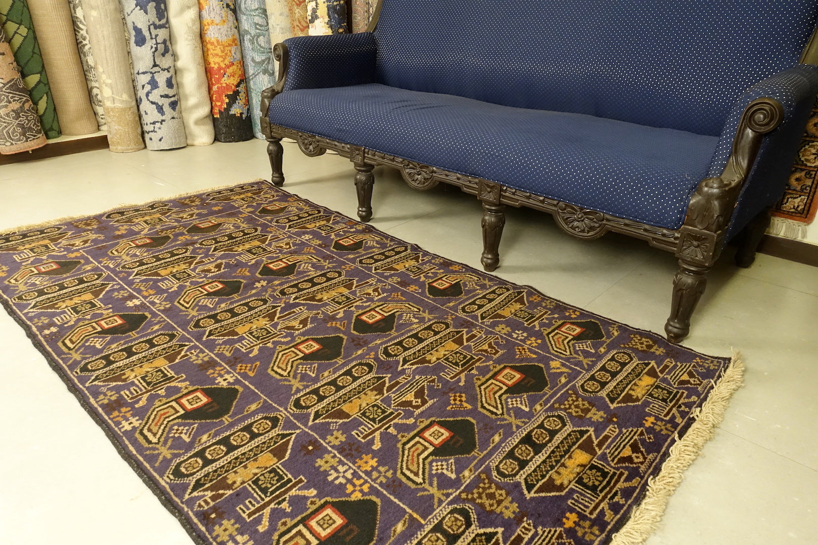This Afghan wool rug measures 3 feet 8 inches by 6 feet 10 inches. The colours used on the rug are blue,red and brown.