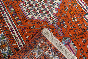 A 4 by 6 feet balochi wool rug, the colours used on the carpet are blue, brick, green and beige.