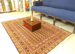 A 4 feet by 6 feet Afghan wool rug, the colours used on the rug are beige,yellow,gree,brown and rust.