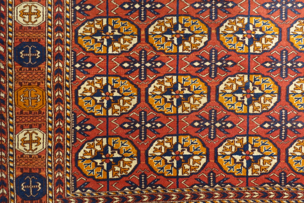 It is a 4 feet by 6 feet wool rug made by jail inmates in central India. The colours used are rust,orange,red,blue and yellow.