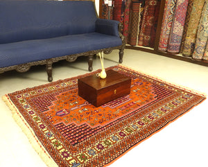 A 4 by 6 feet balochi wool rug. Shades used are primarily brick, purple, green, beige, black and cherry.