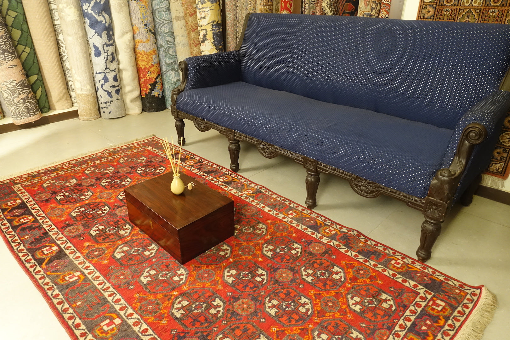 A 3.75 feet by 7.5 feet antique turkoman rug, the colours used on the rug are deep red,blue,yellow,pink and rust.