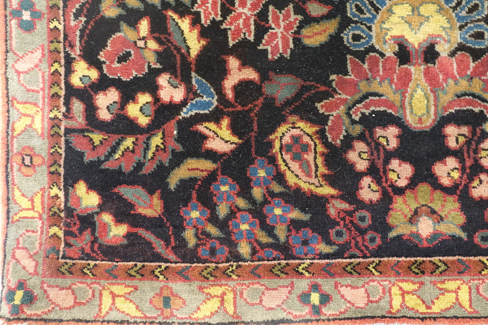 It is a 4 feet by 6 feet indian wool rug. The colours used in the rug are blue,red,beige and pink.