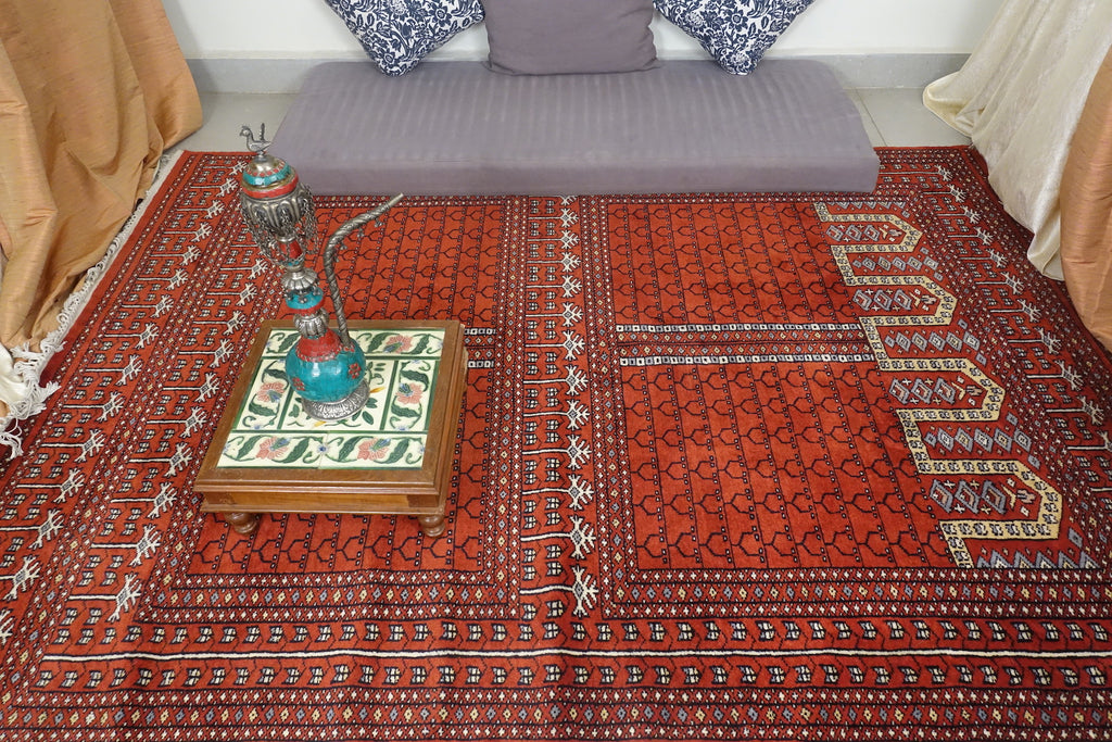 It is a 5 feet by 7 feet rug, the colours used are brick red, black, blue and beige.