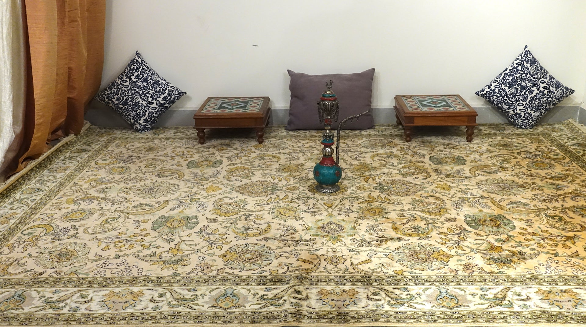 6 feet by 9 feet kashmiri silk on silk rug. The colours used on the carpet are cream,gren,brown,muave and blue.