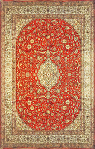 A 9 feet by 12 feet Kashmiri silk on silk carpet/rug. The colours used on the rug are rust,red,beige and golden brown.